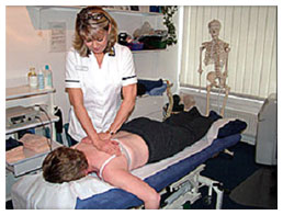 Client receiving back treatment